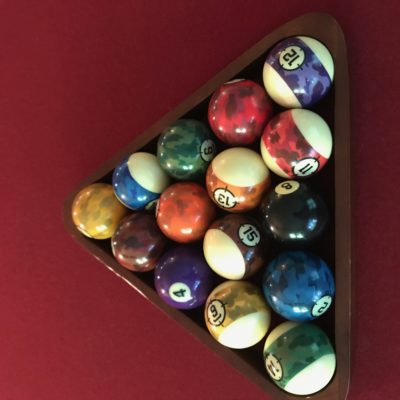 Lightly used pool table for sale with custom camouflage ball set